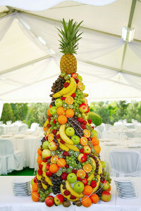 Party Marquee with Fruit Display on Table in Pyramid Shape