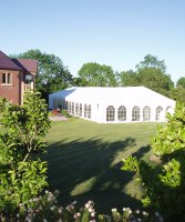 Marquee next to house in a garden setting