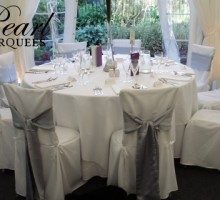 White Chair Covers and Silver Chair Sashes