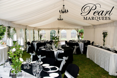 White Sashes And Black Chair Covers Theme Marquee Decoration