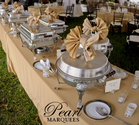 Beige coloured buffet table marquee decoration