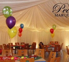 Uplighters give ambience to a party marquee