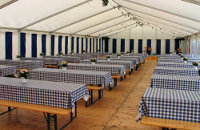informal corporate marquee event in chequered blue company colours